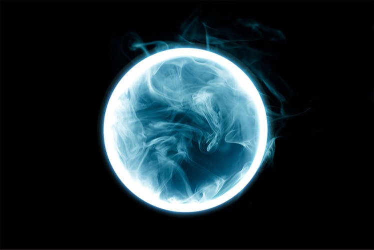 Smokey neon circle on a dark background
