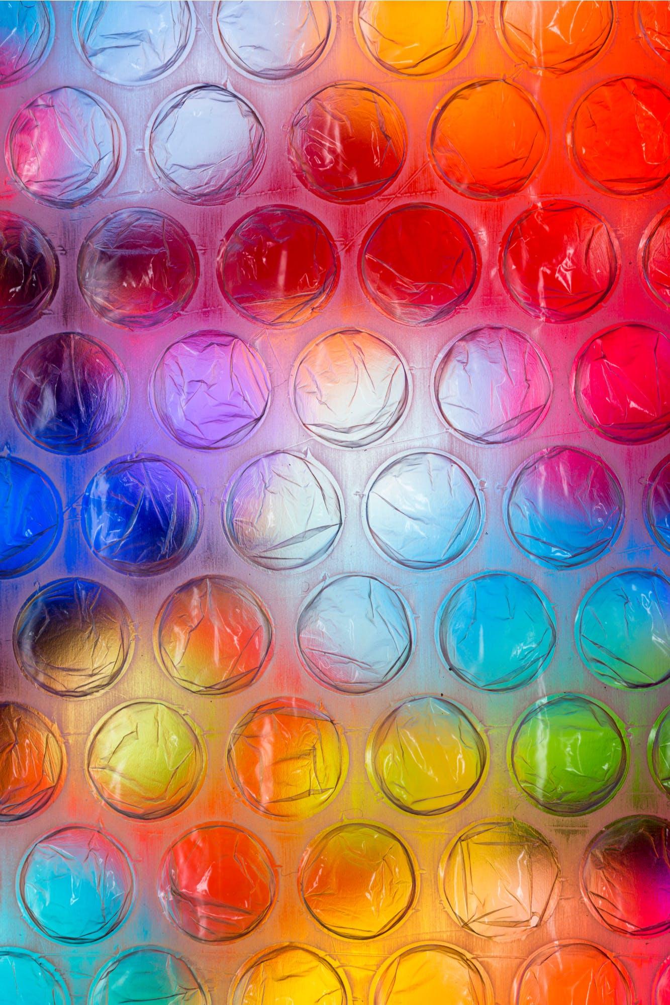 close up bubble wrap on multicoloured background