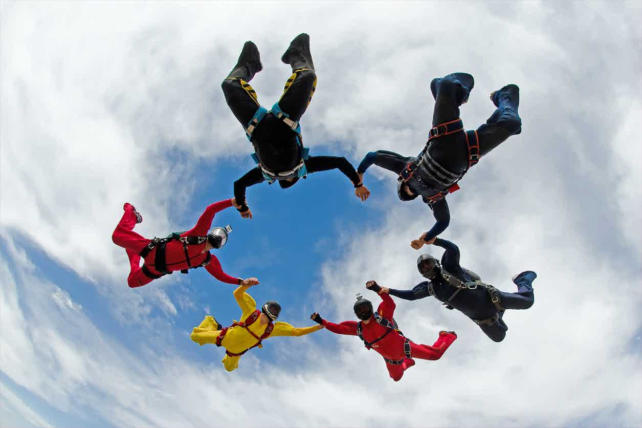 skydivers holding hands in ring