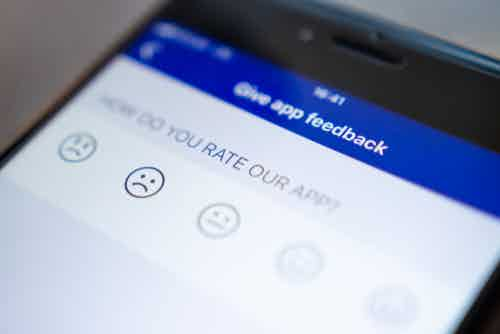 Mobile screen on 'give app feedback' page. Editorial credit: Dzmitrock / Shutterstock.com