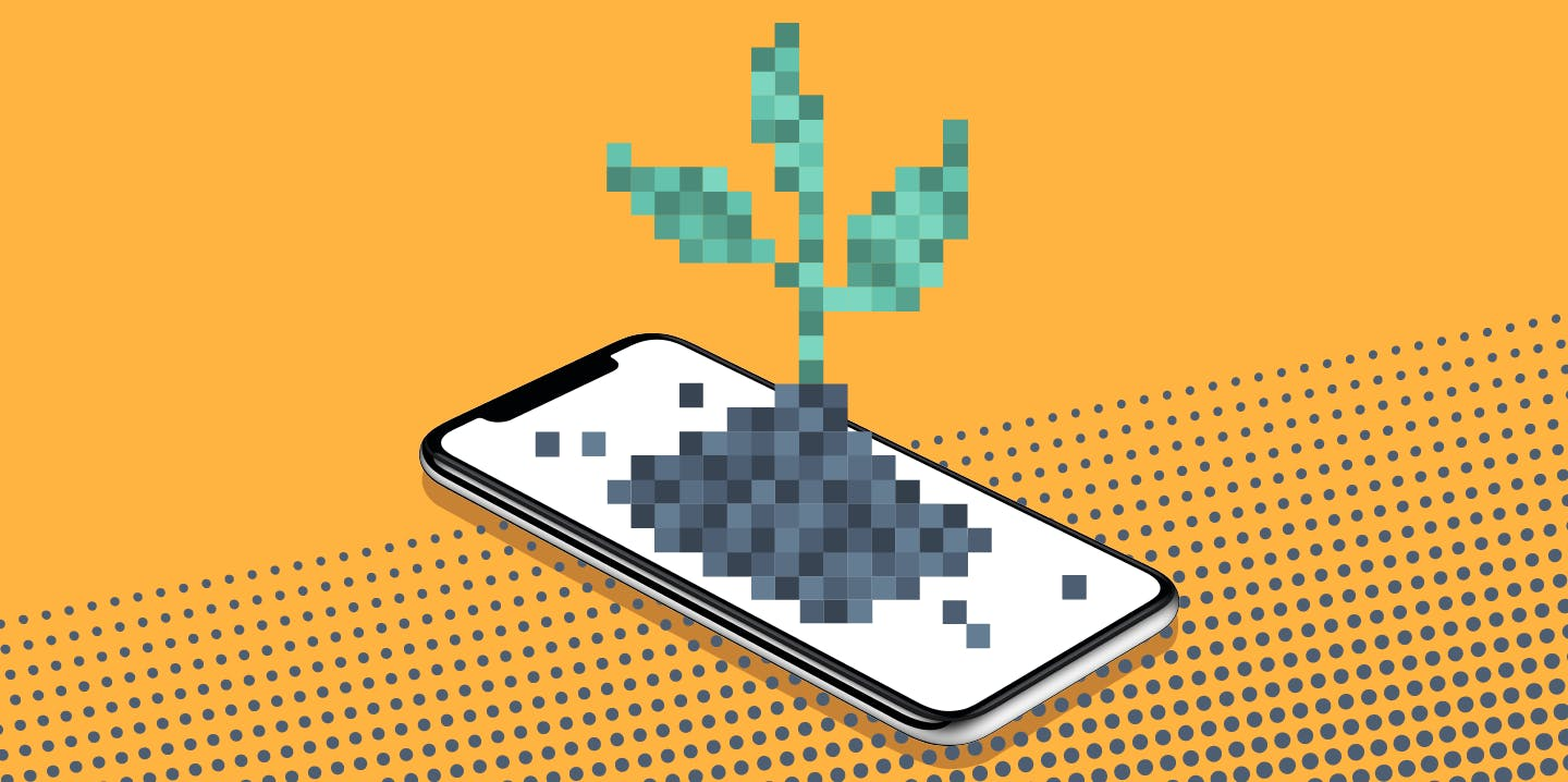 plant shoot growing out of mobile phone
