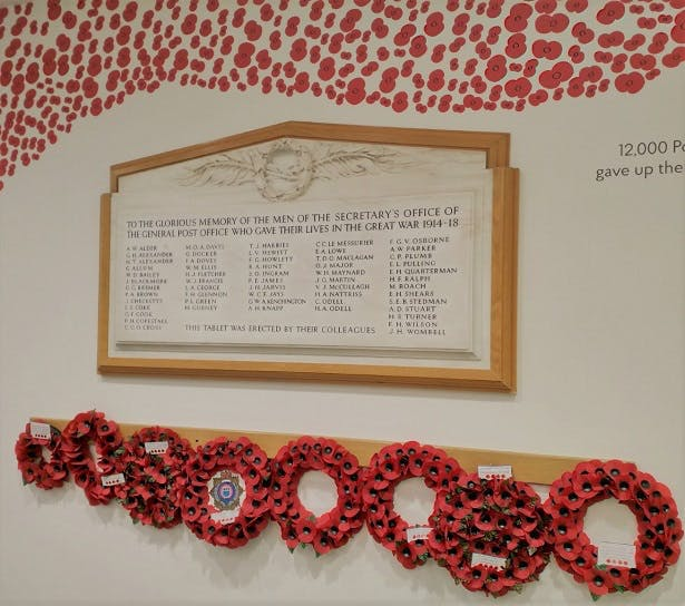 A memorial wall with poppy wreaths and a large framed plaque, dedicated to the men of the General Post Office who gave their lives in the First World War.