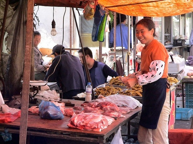 A woman shopping at a food market in China