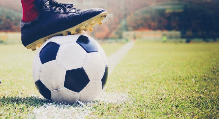 football-soccer-boot-on-ball-pitch