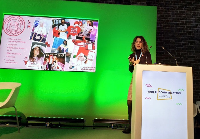 Martina Longueira with a slide detailing Hello Kitty's micro-influencer strategy