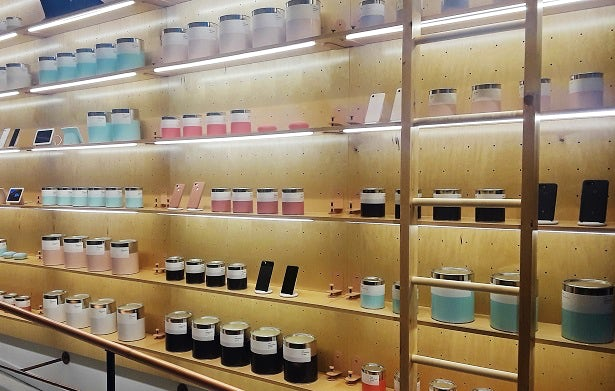Rows of pretend paint cans sit next to smartphones and tablets inside Google's Hardware pop-up.