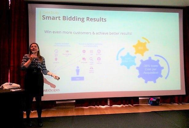 Rumyana Miteva speaks in front of a presentation slide at the Leaders in Travel Marketing event.