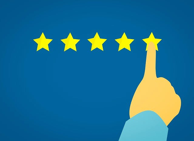 Five gold stars against a blue background, with a finger pointing to the last star.