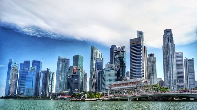 Photograph of the Singapore skyline, with skyscrapers lining the harbour.