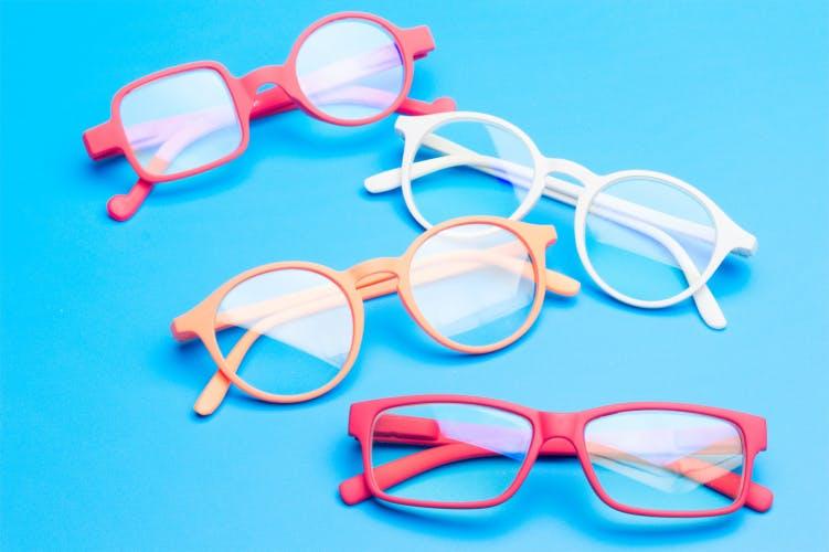 Glasses on blue background