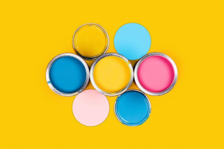 Multicoloured tins of paint arranged in hexagonal formation