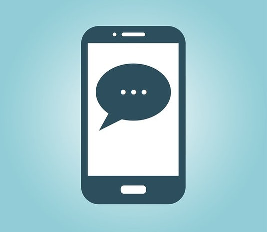 Graphic of a mobile phone with a speech bubble on its screen