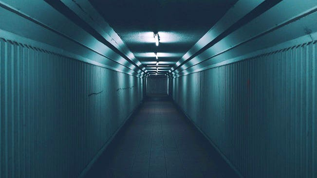 A dark, dimly-lit tunnel