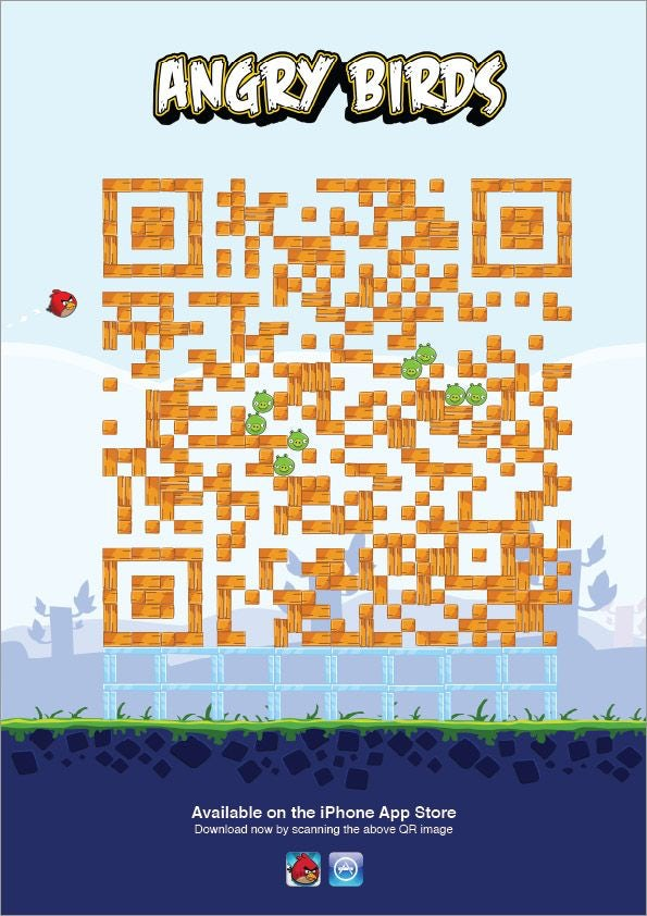 A promotional poster for the mobile game Angry Birds. In the middle is an orange QR code designed to look like an Angry Birds game, complete with little green pigs.