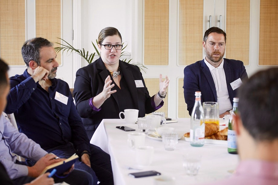 Close-up of marketers discussing the customer journey at the Facebook roundtable