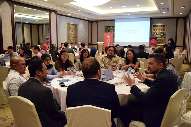 Attendees discuss content marketing at the Oracle/Econsultancy roundtable event in Jakarta