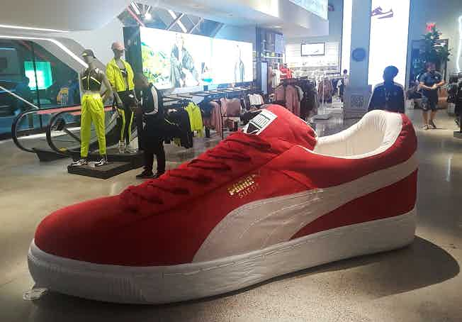 A giant suede classic sneaker inside the Puma flagship store.