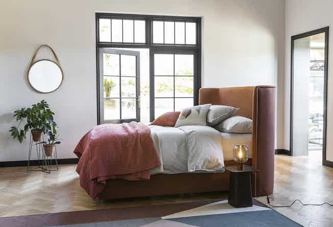 heals monroe bed near window with mirror