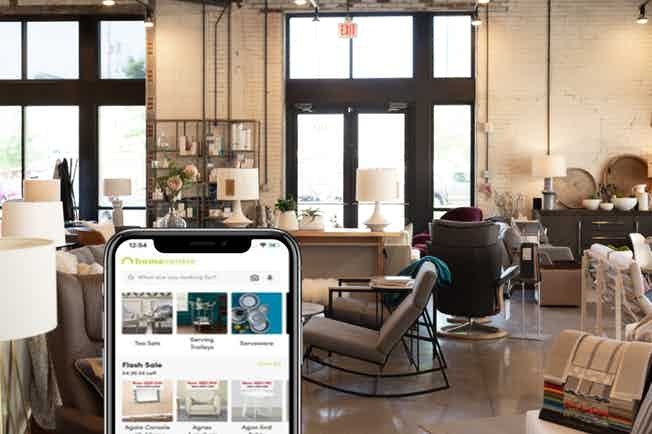 Homecentre on mobile phone in front of home decor
