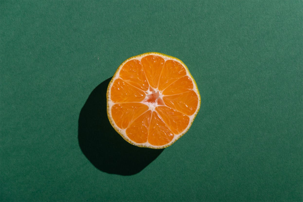 bisected orange on green surface