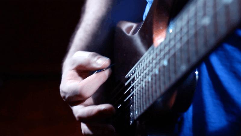 guitar being strummed