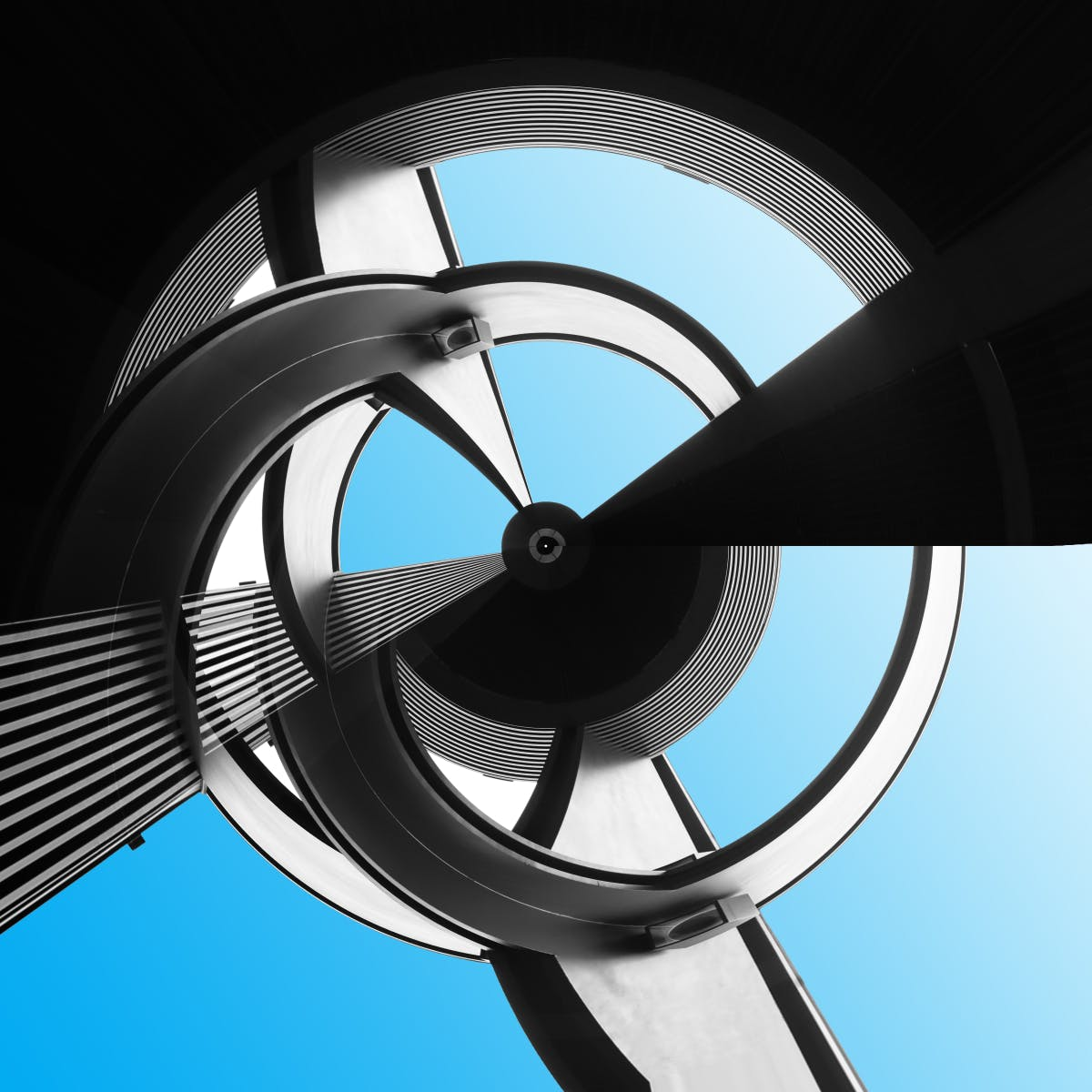 Sky visible through curvilinear structure of steel and glassers cover image