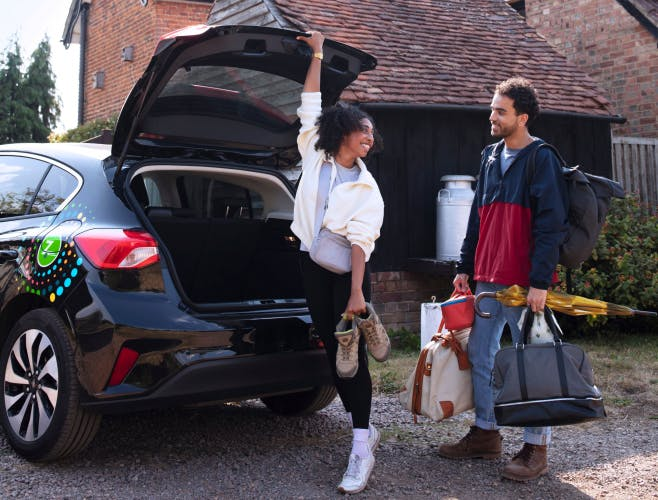 Couple unpacking Zipcar