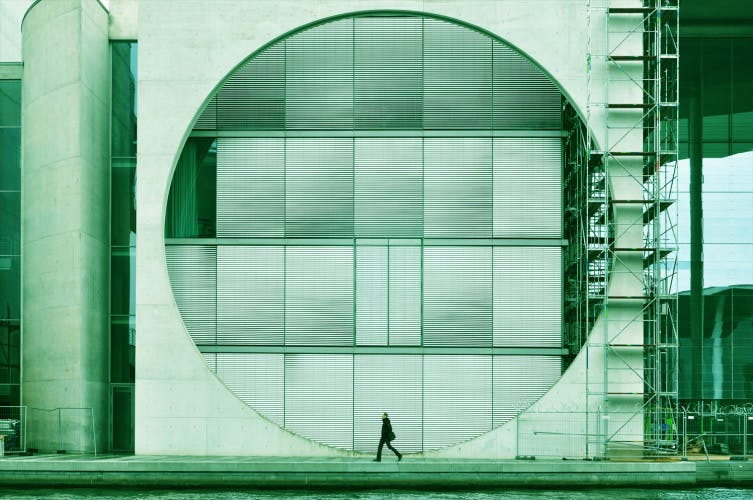architectural composition with circle and walking man green filter