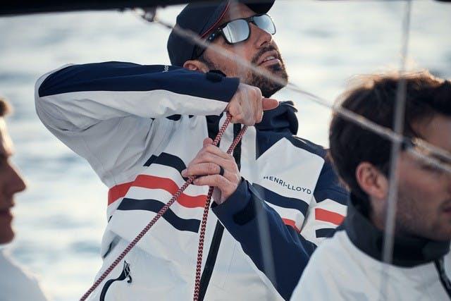 Henri Lloyd model wearing sailing jacket on boat
