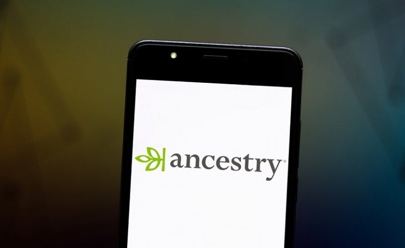 A smartphone screen with the Ancestry logo on it